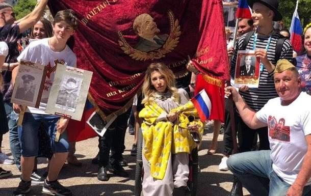 Российская делегация в Лиссабоне пронесла флаги